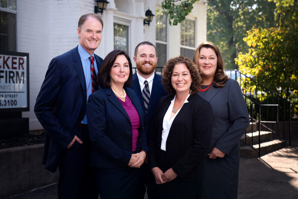 Crocker Law Firm's attorney team with Ben Crocker, Cyndi Crocker, Joseph McReynolds, Angela Kniery, and Robin Hewitt, are standing in front of the Crocker Law Firm Personal Injury Attorneys building in Bowling Green, Kentucky
