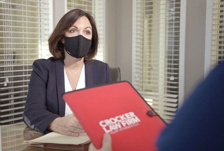 Cyndi Crocker Car Accident Lawyer meeting with a client wearing a mask for COVID-19 safety in a conference room