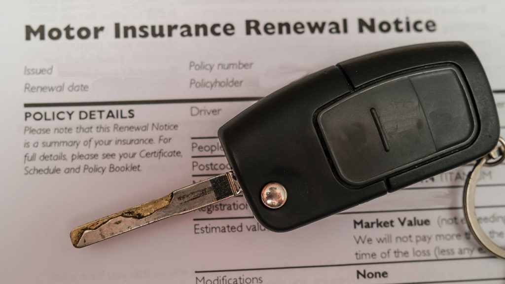 Motor Insurance Renewal Notice document with a car key laying on it