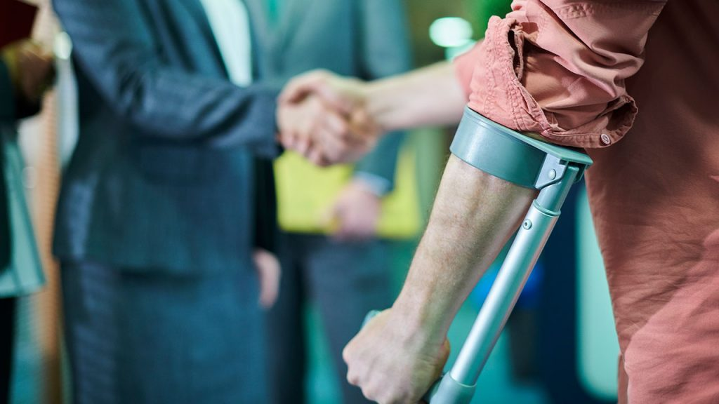 Injured man shakes hands with man wearing suit for Crocker Law Firm blog post