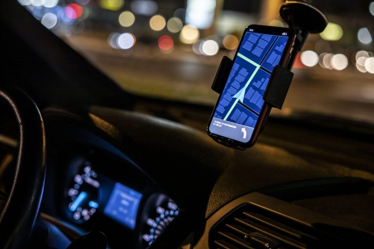 A Lyft driver's GPS instructs him on where to turn. Ridesharing apps have become more popular in recent years.