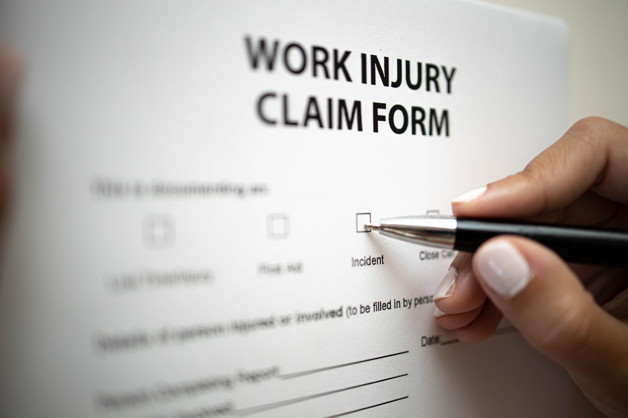 Persomn Filling a Work Injury Claim Form
